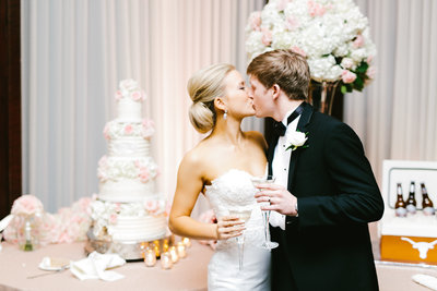 Bride and Groom cake cutting at a Brae Burn Country Club Wedding in Houston, Texas