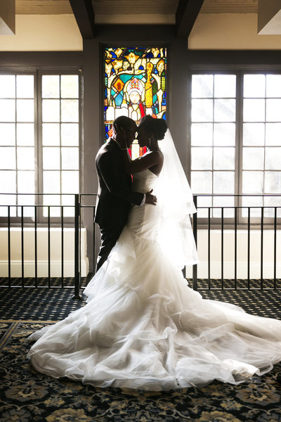 couple portrait stained glass window mission inn riverside wedding