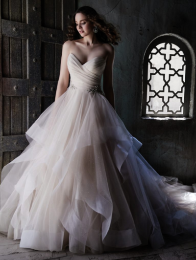 "To flip the ""ball gown wedding dress"" script, one might consider sparkle tulle in tiered layers. Everything else just feels dull in comparison."