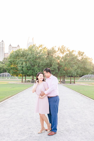 A couple at their engagement session at Piedmont Park in Atlanta Georgia by Jennifer Marie Studios, best Georgia wedding photographer.