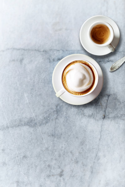 bigstock-Cup-of-Cappuccino-and-a-Cup-of-187732387