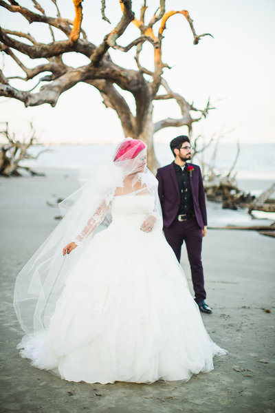 driftwood beach wedding ethereal pose