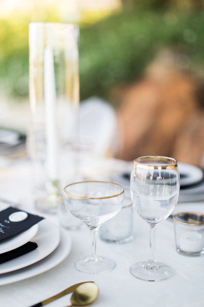an outdoor table scape with glassware and ceramics