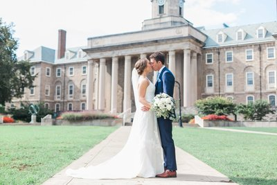Bride and groom at Old Main at Penn State University wedding by the Jepsons