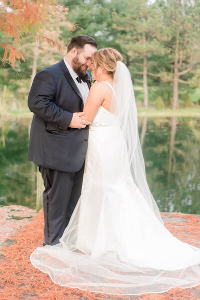 Bride and Groom Portrait in front of a pond