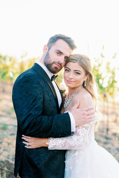 Temecula  winery wedding photography with glamorous couple in the vineyards
