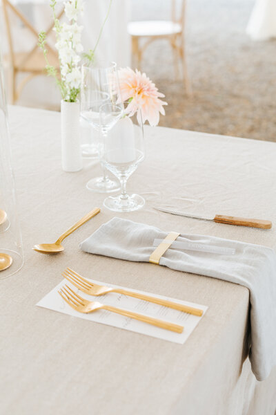 Elegant Table Details with Gold Flatware, summer linen, and florals at Elegant Idaho Wedding