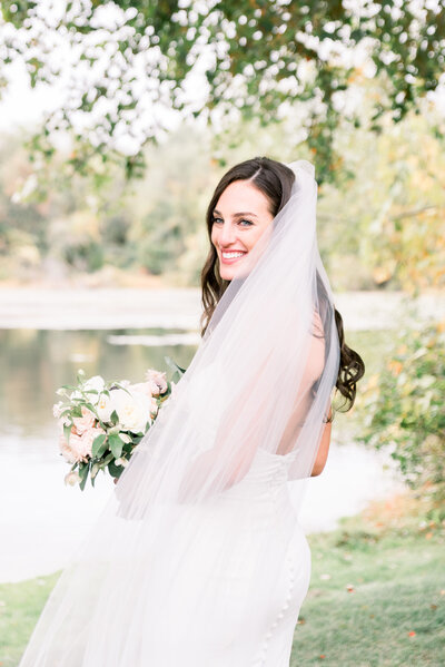 New Jersey bride in park photo captured by NJ wedding photographer Myra Roman