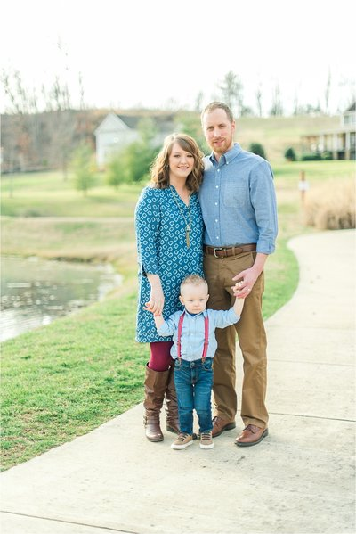 Family of three smiling at the camera by Knoxville Wedding Photographer