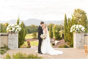 bride and groom in courtyard at Hotel Domestique