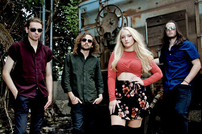 Nashville Tennesse band portrait Juliana Hale And Band of Roses standing against trailer and trees
