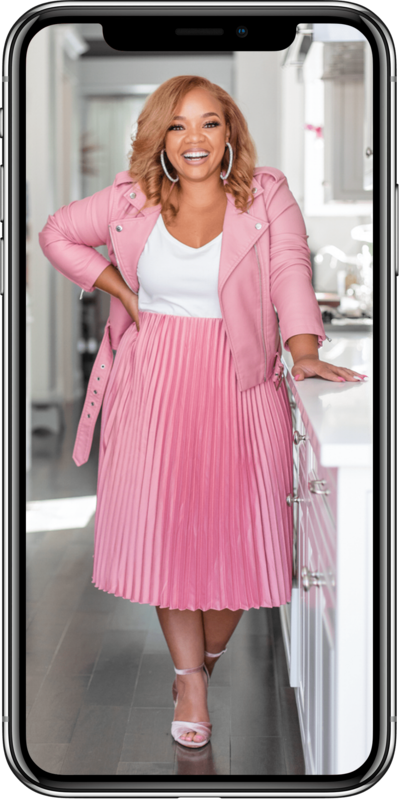woman in a pink jacket and pink skirt smiling inside of an iphone