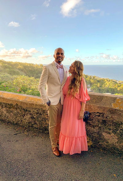 Candice and her husband Jason dressed fancy for a wedding overlooking the gorgeous views of Barbados