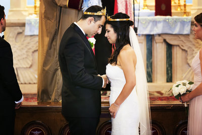 couple bow heads with crowns armenian wedding photographer la