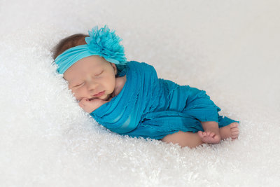 Celesta Champagne specializes in Newborn Photography