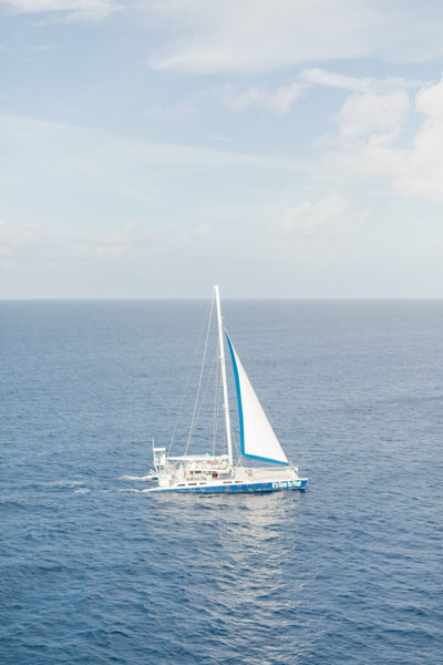 sailboat in the ocean at  Destination Cruise Wedding at Turks and Caicos by Costola Photography