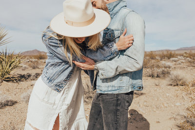man and woman wearing denim jackets