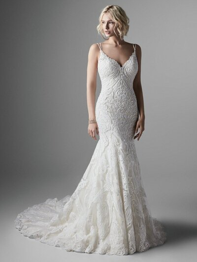 Lace Fit-and-Flare Wedding Dress. A lace fit-and-flare wedding dress will never go out of style. Opt for double spaghetti straps and a bold motif for a chic twist on this enduring classic.