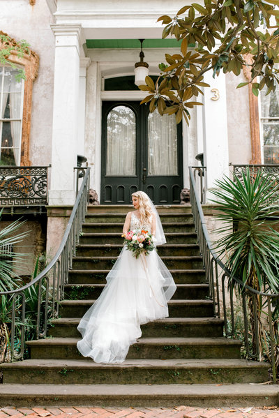 Ivory and Beau bride Shannon on the steps of Raskin Antiques on Monterey Square Savannah