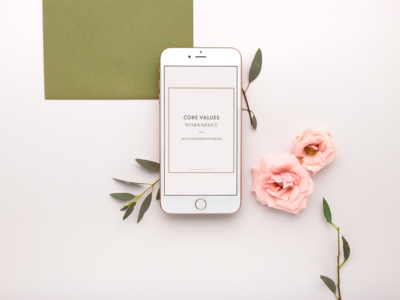 iphone-mockup-lying-with-flower-heads-and-stems-21758