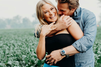couple laughing and hugging  in couples photoshoot