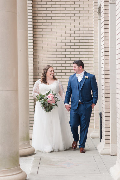 bride and groom at historic post office wedding by hampton roads virginia wedding photographer
