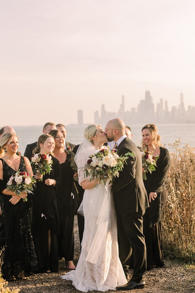 Wedding party poses at Montrose Harbor in Chicago