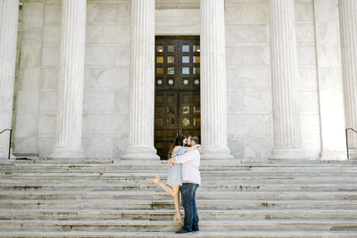 Bride and groom walk up memorial steps at their DC wedding