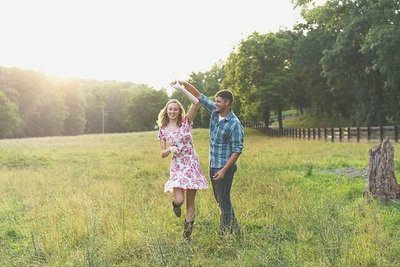 country couple celebrates engagement in field in Clarksville TN she said yes