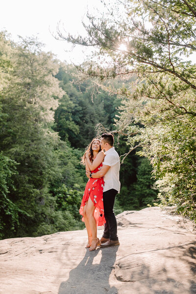 candid dancing couple at adventurous nashville engagement session at fall creek falls state park
