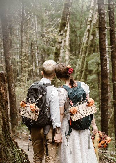 Just eloped signs hanging from backpacks in the Oregon wilderness.