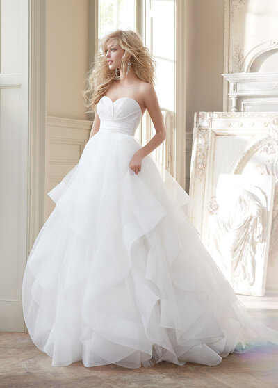 Hayley Paige bridal gown - Ivory strapless natural waist bridal ball gown with silk radzmir crossover bodice, full tulle skirt with horsehair flounces and chapel train.