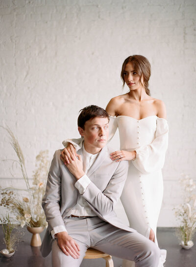 Bride and groom pose for photo at intimate wedding