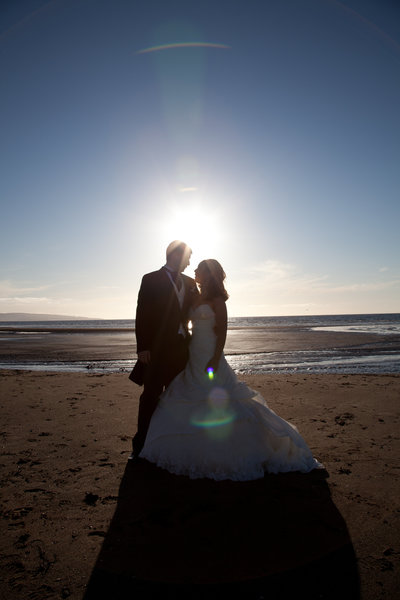 Bride and Groom silouhette at Troon Beeach