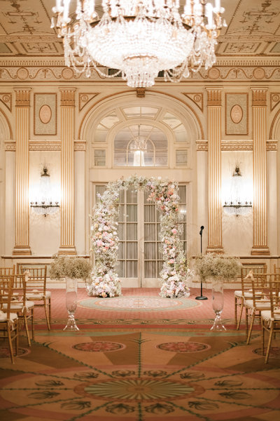 modern baby breath ceremony arch with pastel flowers at the brown hotel with tall baby beath centerpieces down the aisle