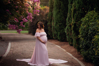 pregnant woman holding belly standing on path 1