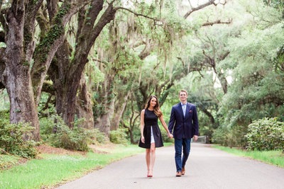 Engaged couple walks down road to the Avenue of Oaks, Magnolia Plantation, Charleston Engagement Photographer