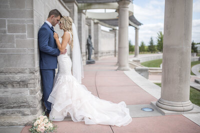 Bride and groom wedding day portraits at Coxhall Gardens in Carmel, Indiana