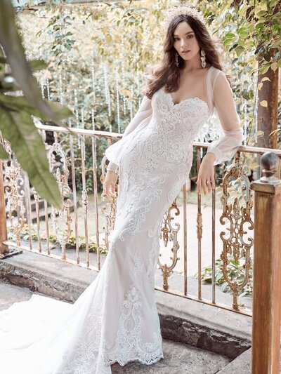Strapless Lace Sheath Wedding Gown. Glamour doesn't always have to be complicated. Sometimes it's a strapless lace sheath wedding gown with the exactly perfect choice of accessories.