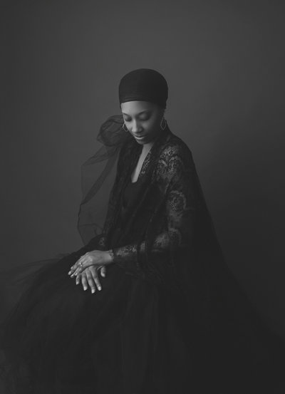 Sanguine Portraiture image of a stunning African-American woman posed elegantly and converted in a beautiful black and white image.