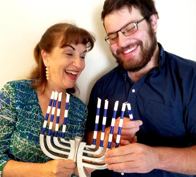 photo-Lauren+&+Ben+&+menorah_upscaled_image[909]