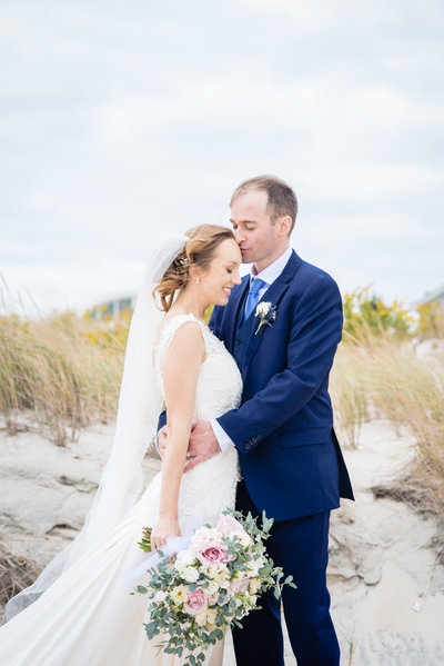 Bride & Groom on beach at Brant Beach Yacht Club in New Jersey
