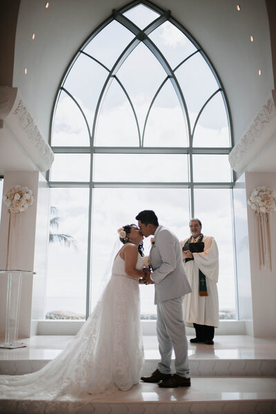 bride-and-groom-kiss-after-ceremony-at-koolina-place-of-joy-chapel