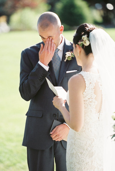 Groom Wiping Away Tear During Wedding Ceremony at Rainbow Ranch