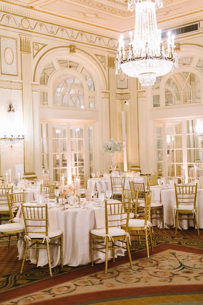 a overview of the ballroom at the brown hotel in louisville with baby breath tall centerpieces and pastel colored flowers with brass candlesticks