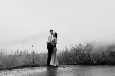 couple sharing a first dance in the rain in rocky mountain national park in colorado