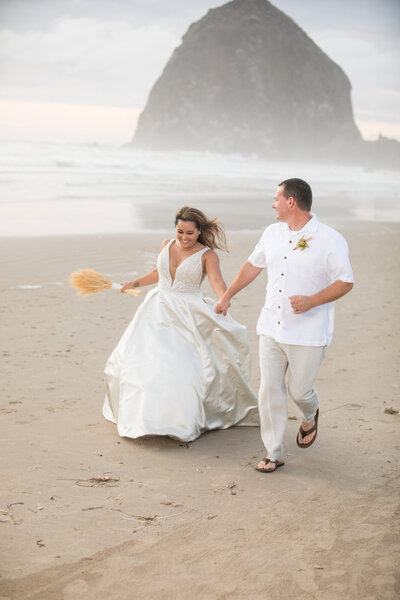 Wedding couple in front of hay stack  rock