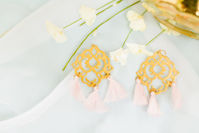 Pink and gold statement earring flatlay