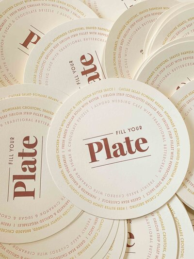letterpress coasters with burnt orange lettering