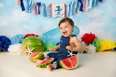 baby boy enjoys a watermelon smash on a cloudy background